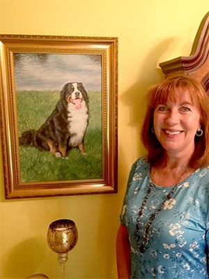 Lady posing with her pet portrait
