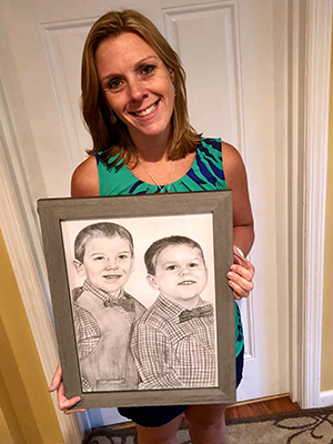 Lady showing her charcoal portrait